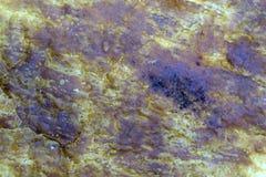 Tekstura żółte świeczka wosku plamy na błękitnym klingerycie zdjęcie stock