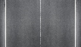 Tekstura asfaltowa droga z ocechowanie liniami Obrazy Royalty Free