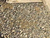 Tekstura - beton i kamienie na ulicie Zamyka w górę strzału Obrazy Stock