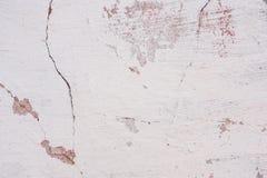 Tekstura betonowa ściana z pęknięciami i narysami które mogą używać jako tło zdjęcia royalty free