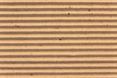 Tekstura brąz gofruje karton jako tło fotografia royalty free