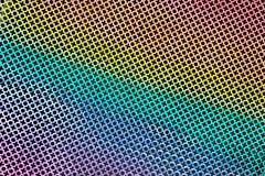 Tekstura dziurkowaty metalu prześcieradło stemplujący tworzyć XO wzór w tęcza kolorze lub uderzający pięścią zdjęcia royalty free