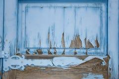 Tekstura jaskrawy błękitny stary drewniany drzwi z farby obierania Obraz Stock