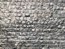 Tekstura małe małe kwadrat płytki, ściany obciosuje kamienne reliefowe tekstur cegły malować z czarną błyszczącą farbą verdure po Fotografia Stock