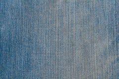 Tekstura niebiescy dżinsy tkaniny zakończenie up zdjęcia stock