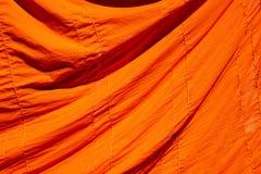 tekstura pomarańczowy kontusz nowicjusz dla tła lub mnich buddyjski fotografia stock