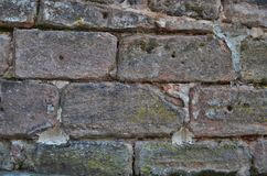 Tekstura stara piaskowiec ściana w tapetowym formacie zdjęcie stock