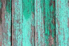 Tekstura stare drewniane deski z krakingową zieloną farbą Obraz Stock