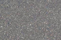 Tekstura tło kamienna czarna szara asfaltowa droga z małymi otoczakami obrazy stock