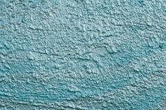 Tekstura turkusowa odbijająca szorstka betonowa ściana Błyszczący błękit ściany tło w górę Malująca szorstka błękita cementu ścia fotografia stock