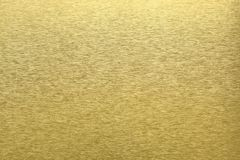 Tekstura złoty metal, abstrakta deseniowy tło, selekcyjna ostrość Fotografia Royalty Free