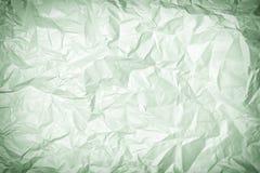 Tekstura zmięty zielonawy papier, tło Fotografia z winietą zdjęcia royalty free