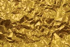 Tekstura zmięta złota kolor żółty folia z wklęśnięcia zakończeniem obraz stock