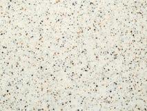 Tekstury światło - szary sztuczny kamień z czerni i brązu kruszkami zdjęcie royalty free