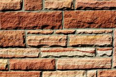 Tekstury tło czerwonego piaskowa ściana zdjęcia stock