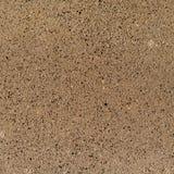 Tekstury tło złożeni kamienie jednakowi brązu granit obraz stock
