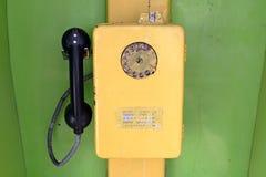 Teléfono amarillo Imágenes de archivo libres de regalías