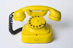Teléfono amarillo Imagen de archivo libre de regalías