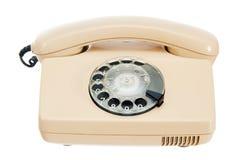 Teléfono analogico viejo con un disco Imagen de archivo libre de regalías