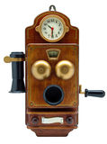 Teléfono antiguo con el reloj en el aislamiento blanco Imagen de archivo libre de regalías