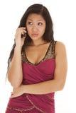 Teléfono asiático de la mujer serio Imagen de archivo