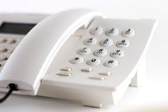 Teléfono blanco Fotografía de archivo