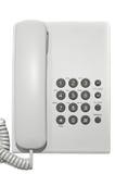Teléfono blanco de la oficina. Imagenes de archivo