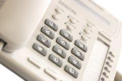 Teléfono blanco del escritorio de oficina Foto de archivo libre de regalías
