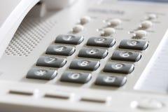 Teléfono blanco del escritorio de oficina Fotografía de archivo libre de regalías