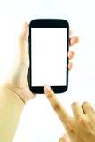 Teléfono celular con la pantalla táctil en mano femenina en el fondo blanco imagen de archivo libre de regalías