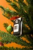 Teléfono celular de la Navidad Fotografía de archivo libre de regalías