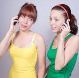 Teléfono celular de las muchachas de llamada Fotografía de archivo