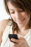 Teléfono celular de marca de la muchacha Foto de archivo libre de regalías