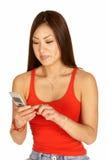 Teléfono celular de marca de la mujer asiática Foto de archivo libre de regalías
