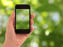 Teléfono celular elegante de Touchphone derecho fotos de archivo
