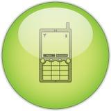 Teléfono celular en el botón verde Fotos de archivo