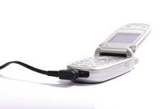 Teléfono celular en el fondo blanco Fotografía de archivo libre de regalías