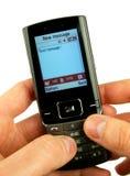 Teléfono celular en una mano foto de archivo