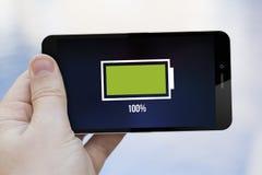 Teléfono celular lleno de batería Fotografía de archivo libre de regalías