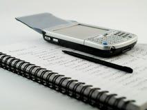 Teléfono celular móvil moderno de PDA en el papel alineado Fotos de archivo libres de regalías