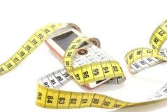 Teléfono celular medido Fotografía de archivo libre de regalías