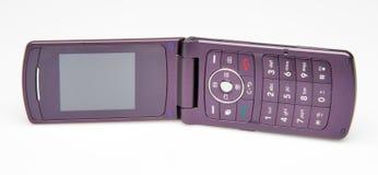 Teléfono celular púrpura Imágenes de archivo libres de regalías
