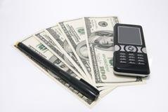 Teléfono celular, pluma y dinero Fotografía de archivo