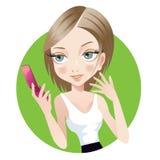 Teléfono celular y muchacha Imagen de archivo