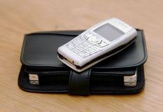 Teléfono celular y organizador Imagen de archivo