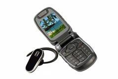 Teléfono celular y receptor de cabeza de Bluetooth Foto de archivo libre de regalías