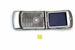 Teléfono celular y tarjeta de Sim Foto de archivo