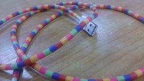 Teléfono colorido de la carga de cable Foto de archivo