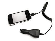 Teléfono con el adaptador Fotografía de archivo libre de regalías