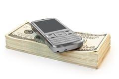 Teléfono con el dinero Fotografía de archivo libre de regalías